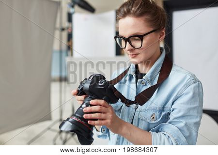 Self-employed stock photographer working in studio