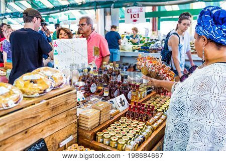 Montreal Canada - May 28 2017: People walking by Maple Syrup products display store stand at Jean-Talon farmers market