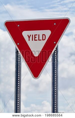 Red and White Yield Sign with blue sky