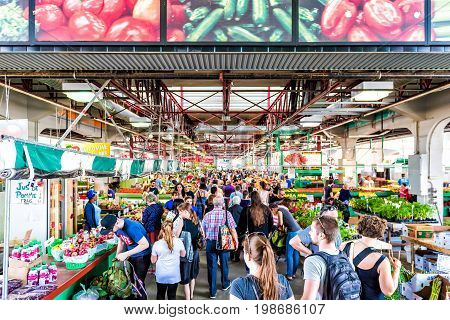 Montreal Canada - May 28 2017: Jean Talon market entrance with people inside building buying produce in city in Quebec region