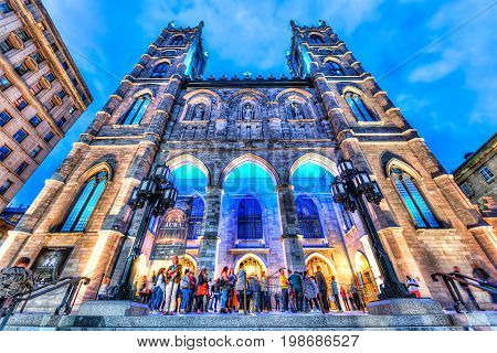 Montreal Canada - May 27 2017: Old town area with Notre Dame Basilica at night in evening outside in Quebec region city