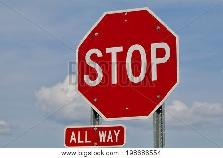 All way stop sign on a blue sky
