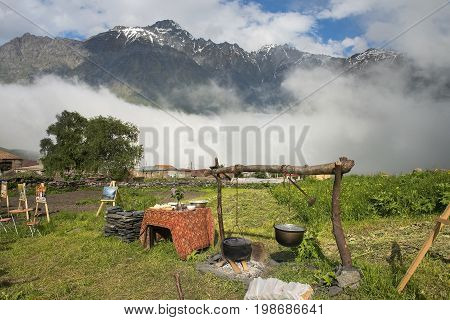 Gergeti, Georgia - 2017 June 16: outdoor Cafe in the high mountain village Gergeti, Georgia, Cafes, which serve national georgian food and you can buy paintings of local artists