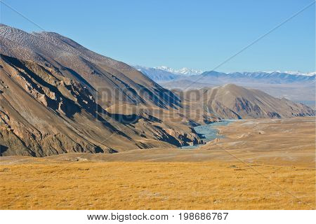 Views of river valley and mountain range in autumn in the Tien Shan. The Issyk-Kul region Kyrgyzstan