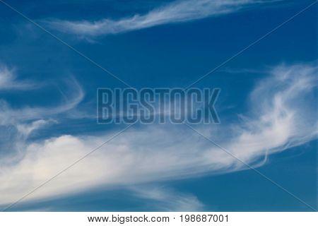 white Wispy Clouds in a deep azure sky