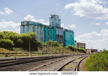 Large industrial elevator, railway, industrial landscape, copy space