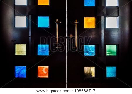 Many small colorful stained glass window squares closeup