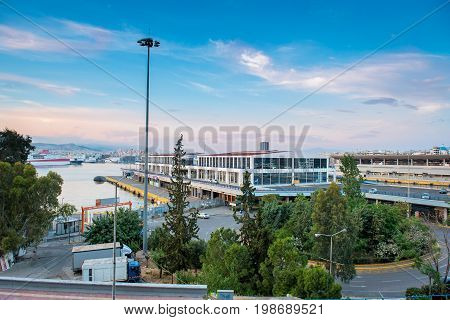 The port of Piraeus with the cruise terminal and the peripheral road under a blue sky .Greece