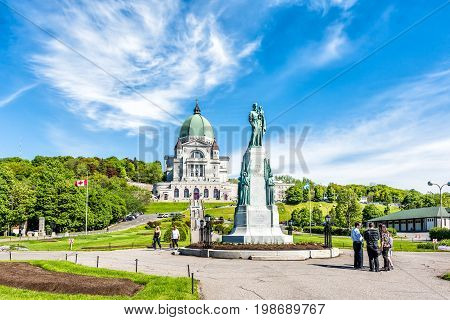 Montreal Canada - May 28 2017: St Joseph's Oratory on Mont Royal with statue in Quebec region city and group of people