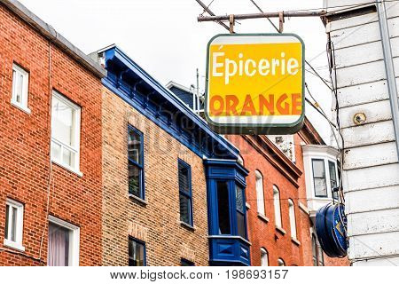 Quebec City Canada - May 29 2017: Grocery store sign with Epicerie Orange name and architecture in old town Saint Jean Baptiste area