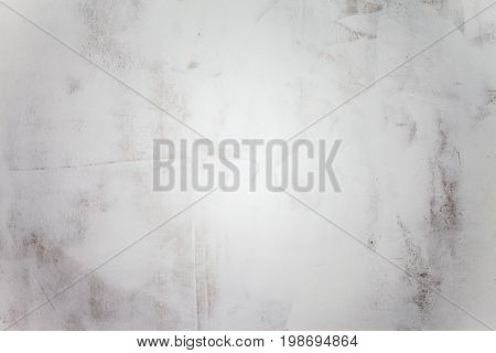 The grunge white concrete old texture wall