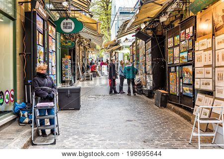 Quebec City Canada - May 29 2017: Old town street called Rue Tresor with shops and people walking