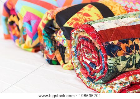 handcraft, ornament, garment industry concept. pack of three twisted veils sewed by invisible thread from pieces of old fabric varied by shade and print