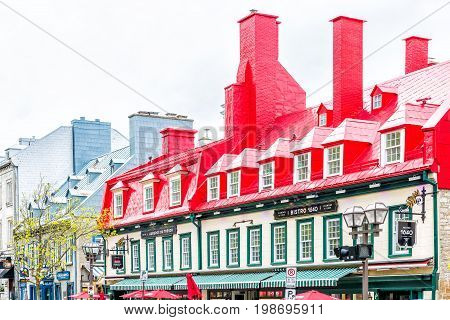 Quebec City Canada - May 29 2017: Old town Sainte Anne street with red restaurant bistro roof