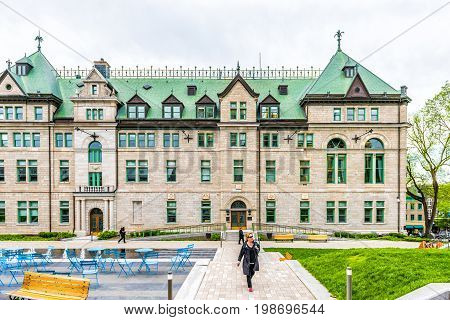 Quebec City Canada - May 29 2017: Old town street with Hotel de Ville City Hall park and people