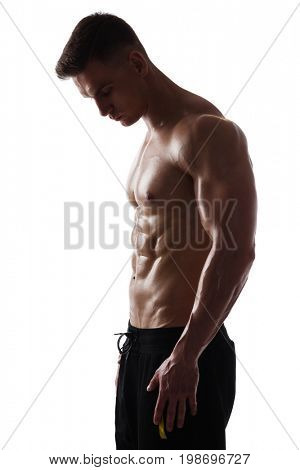 Handsome athletic man posing on white background