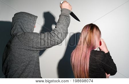 Robbery stalking a woman and holding a knife
