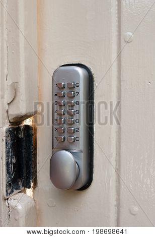 close up of door lock metal code numbers protection; UK