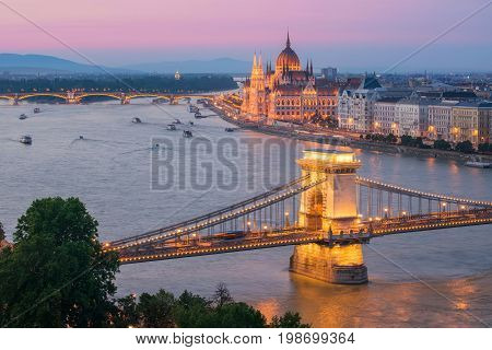Scenic view of Budapest citylights from Castle Hill with Danube river Chain Bridge and Parliament Building at twilight Budapest Hungary