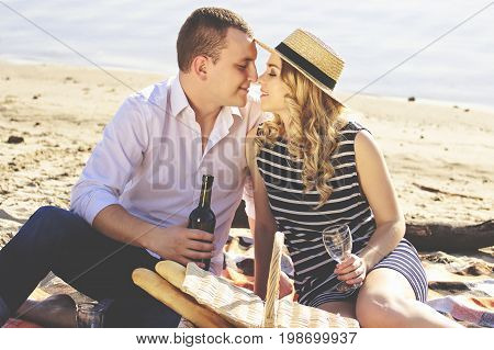 My Honey Girl. Portrait Of Handsome Man In Casual Clothing Keeping Bottle With Wine In His Hand Whil