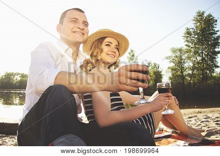 Happy Together. Low-angle Shot Of Beautiful And Young Couple In Casual Clothing Looking Away And Smi