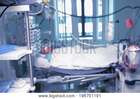 Unconscious patient in the intensive care unfocused background.