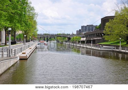 OTTAWA, CANADA - MAY 15, 2012: Lady By cruise ship on Rideau Canal in downtown Ottawa, Ontario, Canada. Rideau Canal was registered as a UNESCO World Heritage Site.