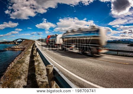 Truck rushes down the highway in the background Atlantic Ocean Road Norway. Truck Car in motion blur.
