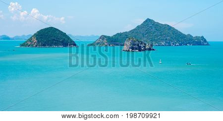 Sea scenery of Khao Sam Roi Yot National Park near Hua Hin city in Prachuap Khiri Khan province, Thailand. Islands and boats in azure waters