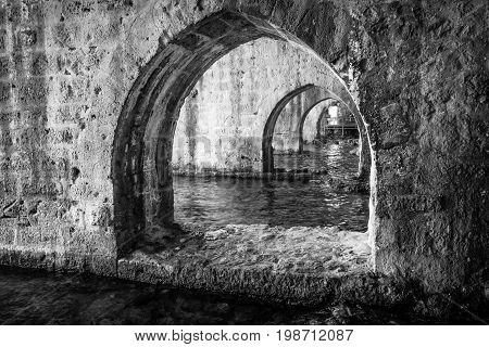 The interior of the shipyard (Tersane) in the ruins of a medieval fortress (Alanya Castle). Alanya. Turkey. Black and white.