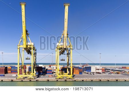 Harbor infrastructure with cranes and containers. Livorno Italy