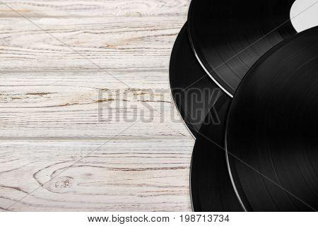 Vinyl records on light white wooden background