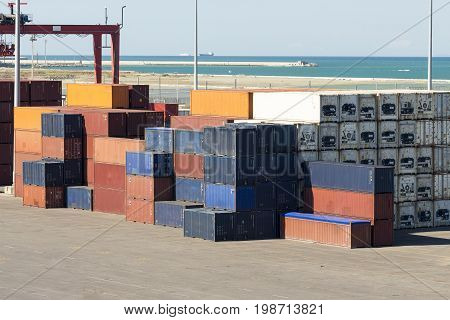 Stacked metal containers. Terminal harbor Livorno Italy