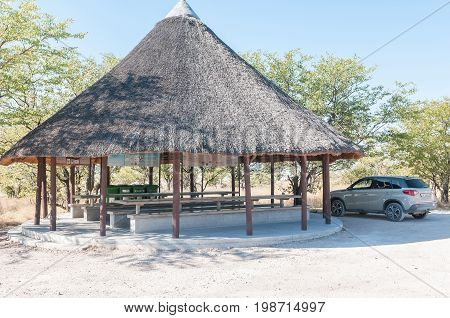 ETOSHA NATIONAL PARK NAMIBIA - JUNE 21 2017: A thatched picnic spot on the C38-road between Namutoni and Halali in the Etosha National Park Namibia