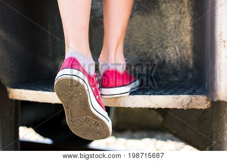 Girl Entering A Vintage Train Wearing Red Sneakers