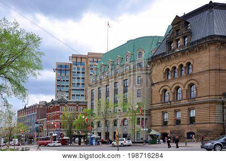 OTTAWA, CANADA - MAY 15, 2012: Historic buildings on Elgin Street at Wellington Street in downtown Ottawa, Ontario, Canada.