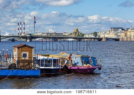 SAINT PETERSBURG/ RUSSIA - JULY 2, 2017. Panorama of the Neva river: view of the pier for river vessels. Saint Petersburg, Russia.