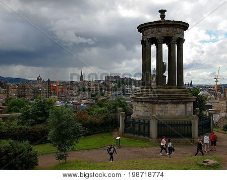 Monument to Dugaland Stewart. Edinburgh, Scotland - July 27, 2017. Monument to Scottish philosopher Dugald Stewart on Calton Hill in Edinburgh.