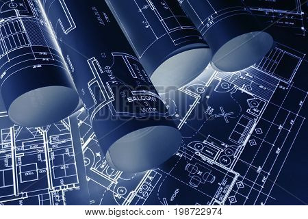 House blueprints blue print style floor plans on architects desk blueprint of a house from a high angle engineering drawings blueprints and house plan blueprints rolled up