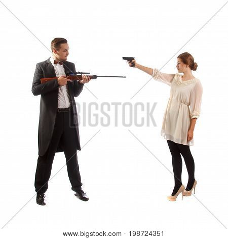 A man holding a rifle and a woman holding a handgun