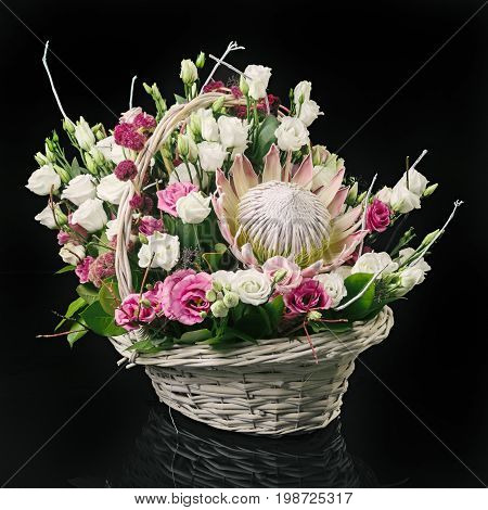 Basket With Flowers On Black