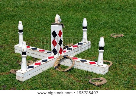 Stratford-upon-Avon UK - July 23 2017: Traditional game of quoits or coits where rope hoops are thrown over a cross shaped target