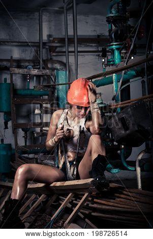 Girl wearing a helmet in the boiler room
