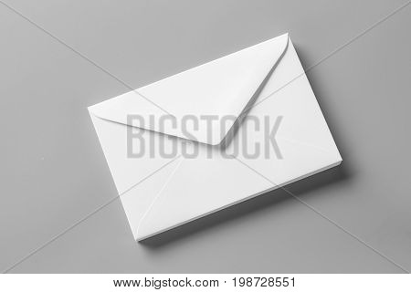 blank realistic envelopes mockup on gray, changeable background / white paper isolated on gray