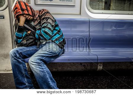 Man Sleeping In The Subway In Manhattan At Around 2Am During The Night