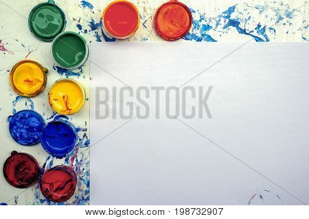 Painting equipment with copy space on white paper texture for Presentations with paint pallete bright color for background