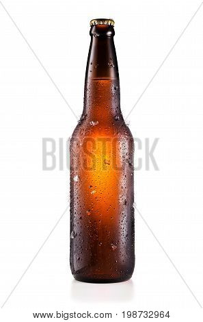 Bottle of beer with drops and ice pieces isolated on white background and with clipping path