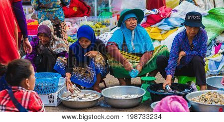 Koh Kong, Cambodia - January 3, 2017: Fish sellers (unidentified) on the central market of Koh Kong. Cambodian women in colorful clothes.