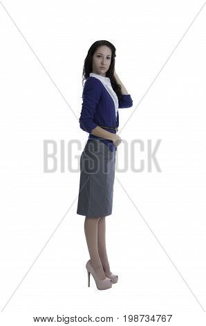 Young business woman preparing for the day before leaving her home.