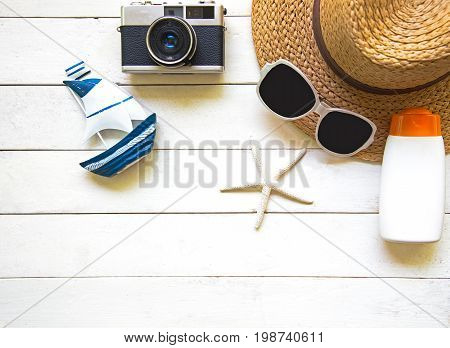 Summer Fashion woman big hat and accessories in the beach. Tropical sea.Unusual top view white background. Summer Concept.
